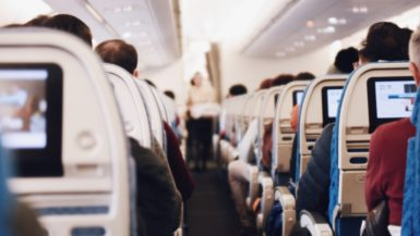 shallow focus photography of people inside of passenger plane